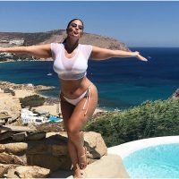 Ashley Graham Rocked a Sexy White Bikini With a Basically Non-Existent Cover Up