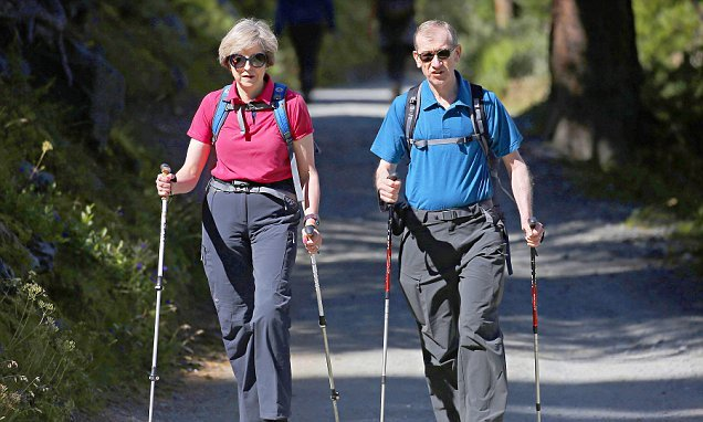 Theresa May heads to Italy and Switzerland on her summer holidays