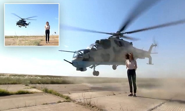 Fearless journalist doesn't budge as choppers fly INCHES from her head