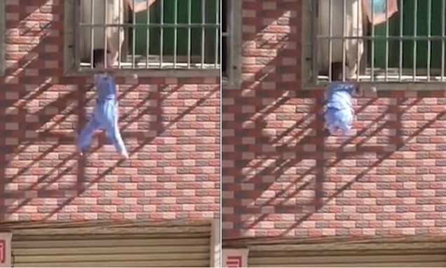Home alone toddler dangles down a window grille by the neck