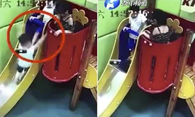 Boy is badly injured after being kicked off a slide by another child