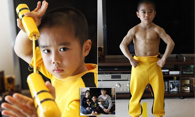 Bruce Lee super fan, eight, does push-ups using his THUMBS
