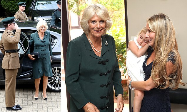 Duchess of Cornwall greets tired young fan as she visits army barracks
