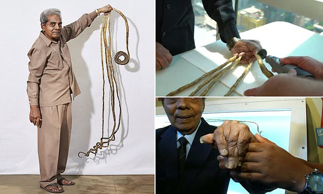 Indian man cuts his 77-INCH long nails after growing them for 66 years