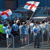 England greeted by fans behind barbed wire as they return from Russia