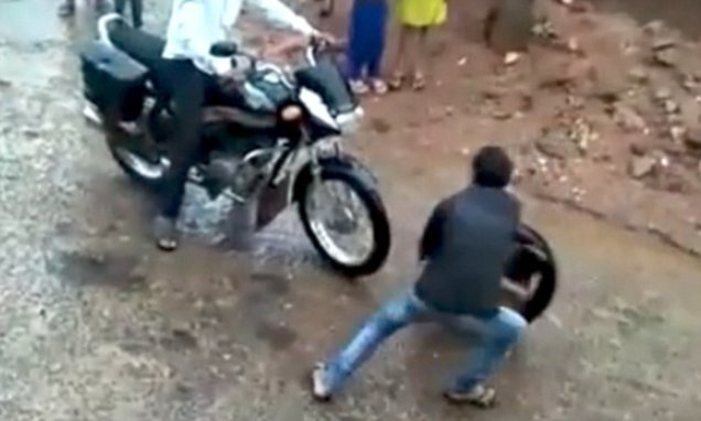 Boy curls up inside a tyre and hurtles down hill before going UP again