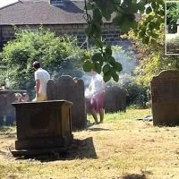 Shameless diners spark outrage by barbecuing on top a TOMBSTONE