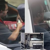 Lorry driver takes both hands off the wheel of his truck