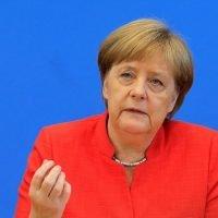 Merkel vows to stay in job, work at