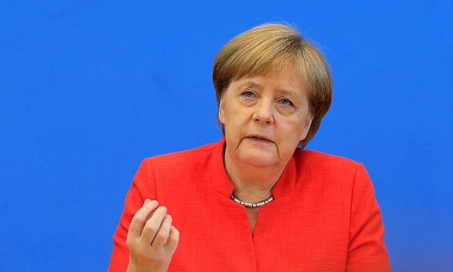 Merkel vows to stay in job, work at