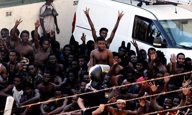 400 migrants storm border and attack security forces to get into Spain