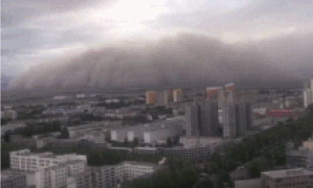 Terrifying footage shows a massive sandstorm devouring a Chinese city