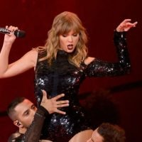 Taylor Swift Is A Third Wheel As Fans Get Engaged In Front of Her