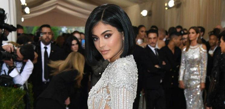 Kylie Jenner Shows Off Post-Baby Body In Metallic Purple Swimsuit