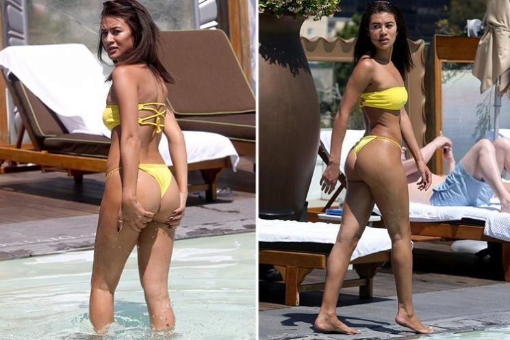 Montana Brown bares her bum in a yellow thong bikini as she soaks up the sun on holiday in Los Angeles
