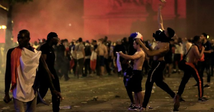 Two France fans die as violence erupts across the country after World Cup win