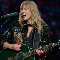 Taylor Swift jokes she's a 'third wheel' as couple gets engaged in front of her