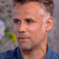 Richard Bacon 'in medically induced coma' and 'fighting for his life'