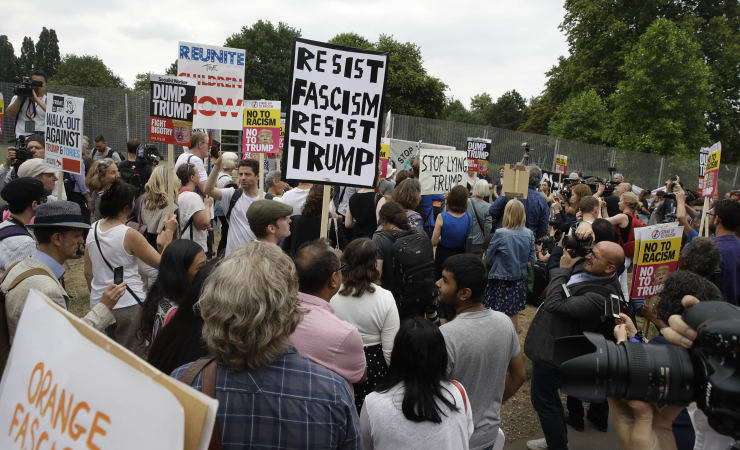 'They like me a lot,' says Trump. 100,000 UK protesters disagree