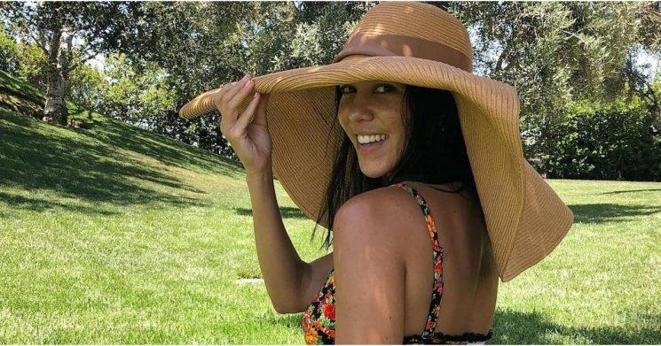 Kourtney Kardashian Basically Exemplifies the Peach Emoji  in This Cheeky Thong Bikini