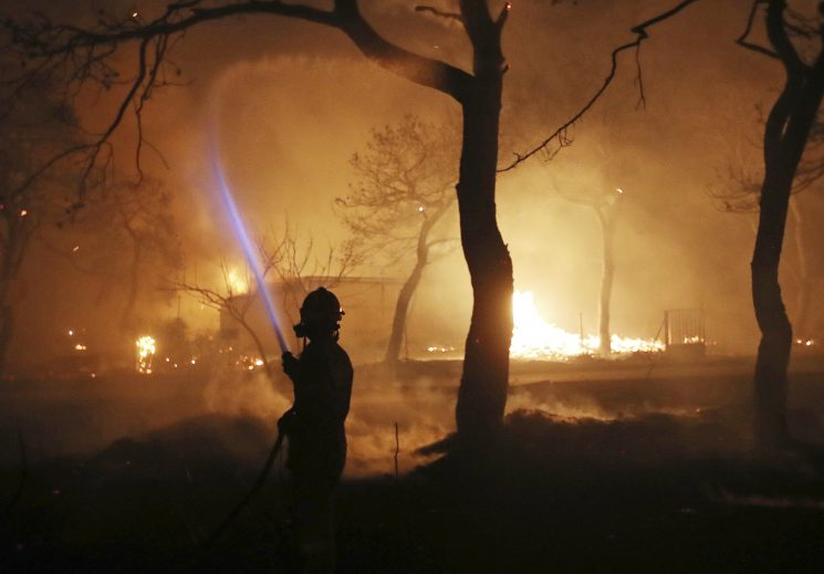 Wildfires near Athens kills at least 24 people, guts resorts