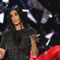 Bruce Willis' ex-wife Demi Moore turns up as a surprise guest at his Comedy Central roasting