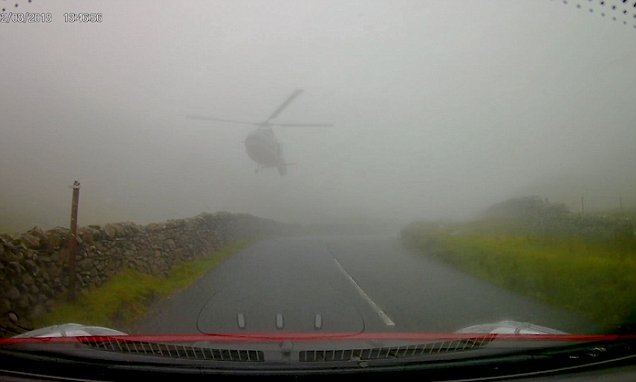 Heart-stopping moment 'SAS helicopter' swoops over fog-bound road