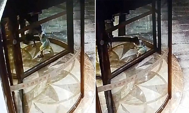 Boy gets foot stuck in REVOLVING DOOR while playing in hotel