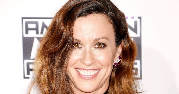 Alanis Morissette Breast-Feeds Next to Hubby and Son: Pic