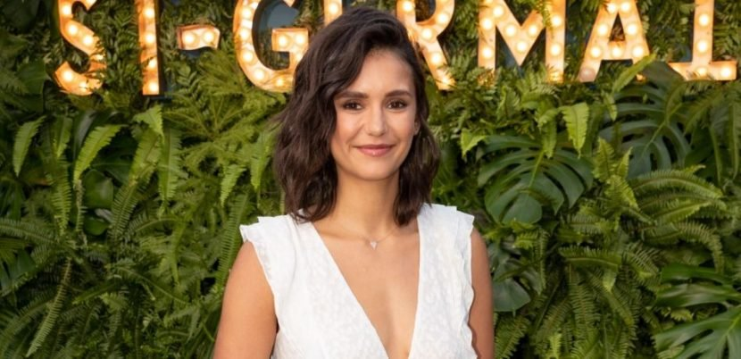 Nina Dobrev Cuddles Up In Bed With Revealing Robe & Teddy Bear On Instagram