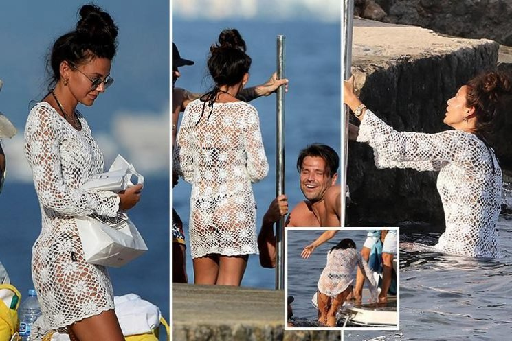Michelle Keegan wears a see-through lace dress over her bikini as she swims in Majorca – while Mark Wright channels his inner Peter Andre