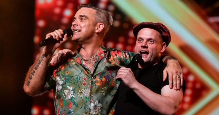Robbie dominates X Factor with more screen time than Simon and impromptu duet