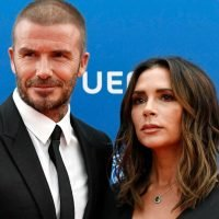 Victoria Beckham wows in chic black dress as she joins David on red carpet