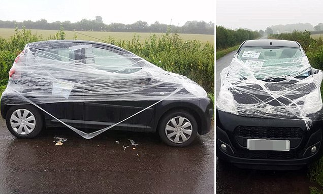 Locals wrap car in CLING FILM after it was left on road near airport