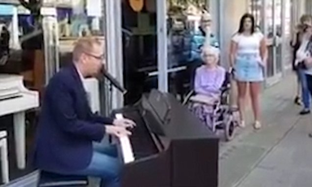 Music shop worker plays PIANO in middle of street with proposal