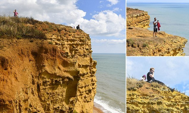 Tourists flout safety warnings and approach 150ft cliff edge