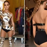 Demi Rose stuns in backless tin foil dress and thigh high boots