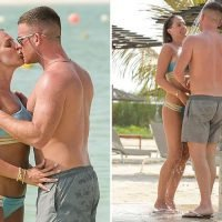 Danielle Lloyd shares an outdoor shower and a passionate smooch with fiance Michael O'Neill on holiday in Dubai