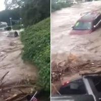 Wild video shows cars floating down river after dealership flood