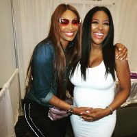 Oh, Baby! Pregnant RHOA Star Kenya Moore Shows Off Bump in a Fitted White Dress