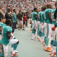 Players kneel, raise fists during national anthem at NFL preseason games