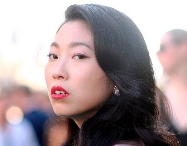 The Powerful Message Behind Awkwafina's Premiere Pout