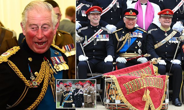 Prince Charles presents the Queen's light-cavalry with new standard
