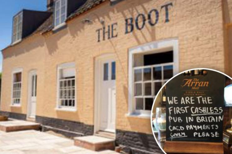 A 16th-century inn has divided customer opinion by becoming Britain's first cashless pub in a bid to reduce the risk of being burgled