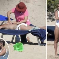 Sam Faiers looks incredible as she goes topless for a beach massage and kisses boyfriend Paul on holiday in Sardinia