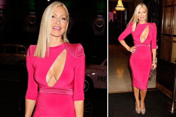 Caprice looks incredible in a plunging hot pink dress for night out in London