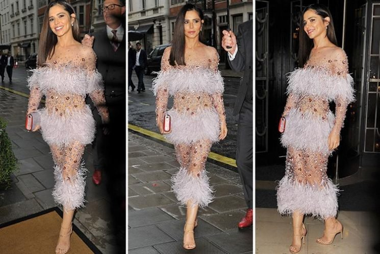 Cheryl looks sensational in sheer dress adorned with feathers at friend's wedding in London