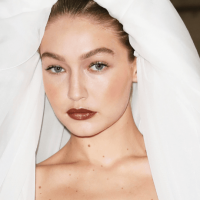Gigi Hadid Stuns In Elaborate Wedding Dress 'Carried By 'Butterflies' At Moschino's Milan Fashion Week Show