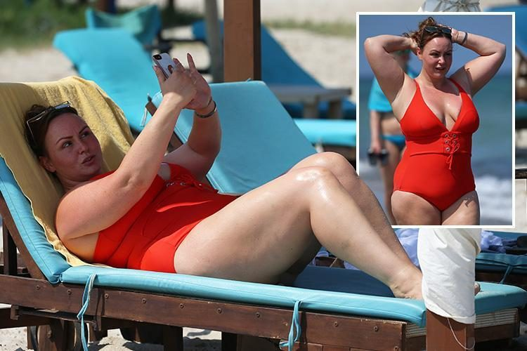 Chanelle Hayes snaps selfies and paddles in the sea in a bright red swimming costume on holiday in Spain