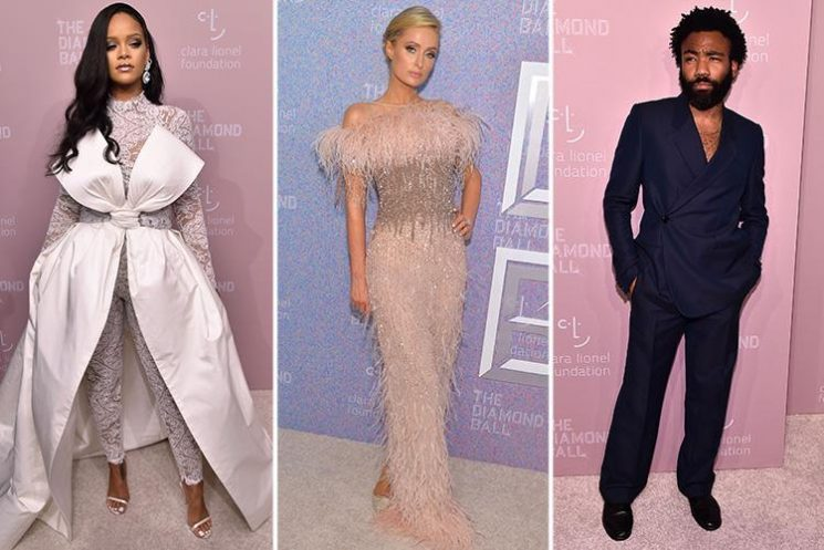 Rihanna looks incredible in white as she parties with Paris Hilton and Donald Glover at annual charity ball